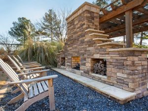 Outdoor fireside lounge with seating at The Laurel apartments for rent in Spartanburg, SC
