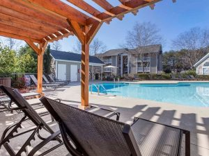 Outdoor swimming pool with sundeck at The Laurel apartments for rent in Spartanburg, SC