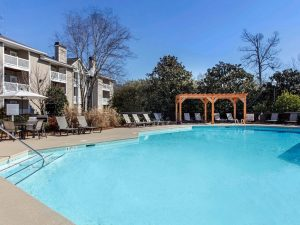 Outdoor swimming pool with lounge chairs at The Laurel apartments for rent in Spartanburg, SC