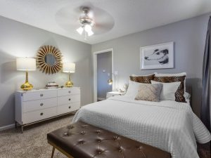 Furnished bedroom with ceiling fan at The Laurel apartments for rent