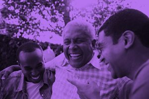 Three men laughing together