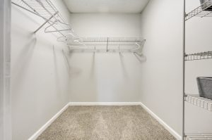 Spacious walk-in closet with ample storage space at The Laurel apartments for rent
