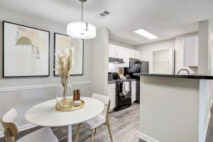 Dining area with view of kitchen at The Laurel apartments for rent in Spartanburg, SC