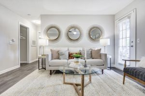 Open-concept living room with ample seating and lighting at The Laurel apartments for rent